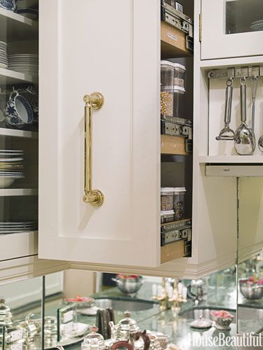 Avoid Searching for Ingredients With a Pull-Out Pantry - and this is in the upper cabinets