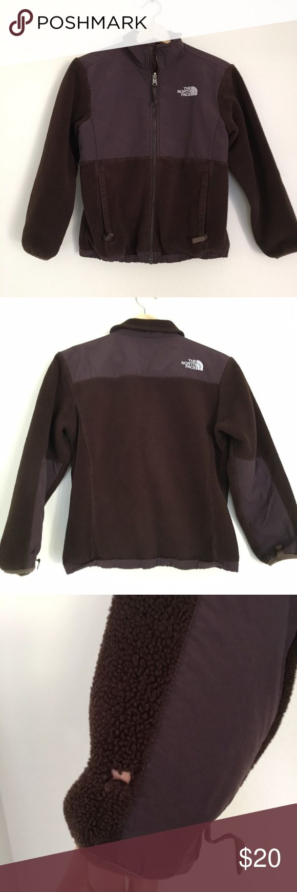 The North Face Girls Denali Zip Fleece Jacket Well loved girls North Face jacket. Polartec Recycled Zip Fleece- brown but almost has a hint of purple to it. Small hole in the back of one Sleeve and small hole in lining of pockets. A great warm jacket perfect for camping! Polyester nylon blend. Measures 18 in at armpits, 20.5 in length, 18in Sleeve. The North Face Shirts & Tops Sweatshirts & Hoodies