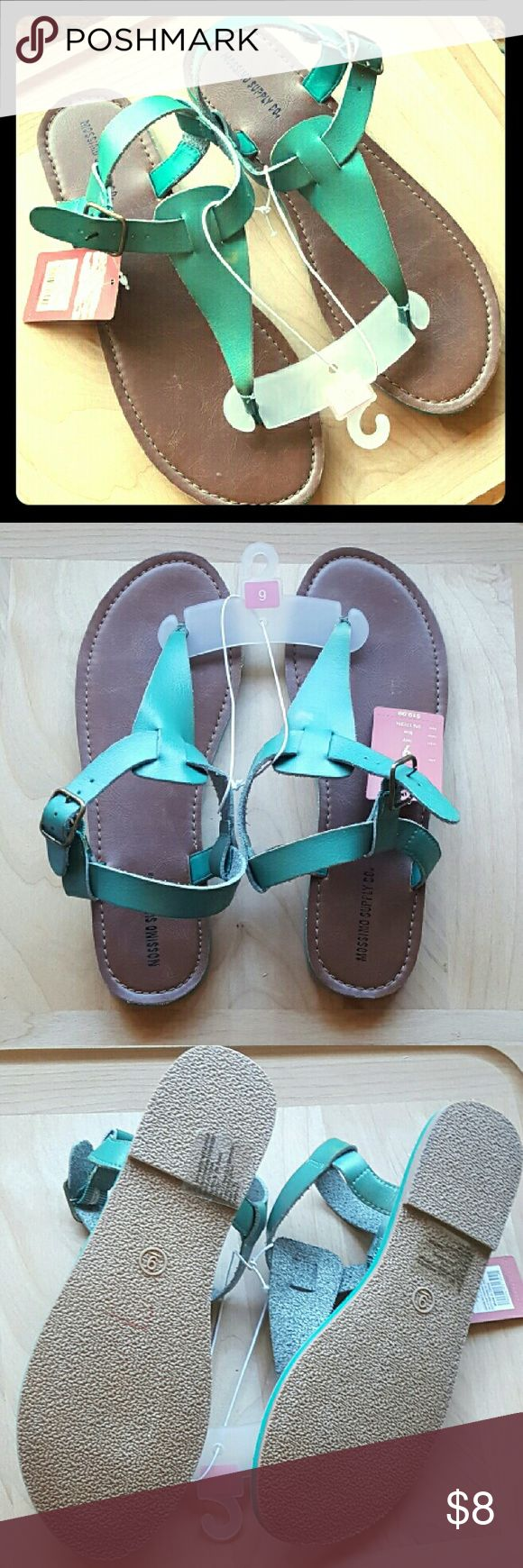 NWT Teal Sandals Mossimo Size 9 New with tags pair of teal sandals. Mossimo brand, size 9.  Never worn. The right sandal has a small area of discoloration, 1/2 inch in size at most. Not sure what it is, it isn't a stain - looks like a little bleached spot? Spot shown in the last pic.  Otherwise in perfect condition. Originally priced $19.99  Comes from a smoke free home! I also offer bundle discounts so check out my closet!  I always ship same or next day :) Mossimo Supply Co. Shoes Sandals