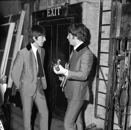 This image of John & George was taken on April 2 1964. During this same period of time, on the week of April 4, 1964, The Beatles would occupy all top 5 spots on the Billboard Hot 100 charts.  In all they placed with 12 songs on the US chart creating music history no doubt.