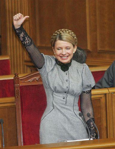 Julia Timoshenko. Grey and black lace business attire.