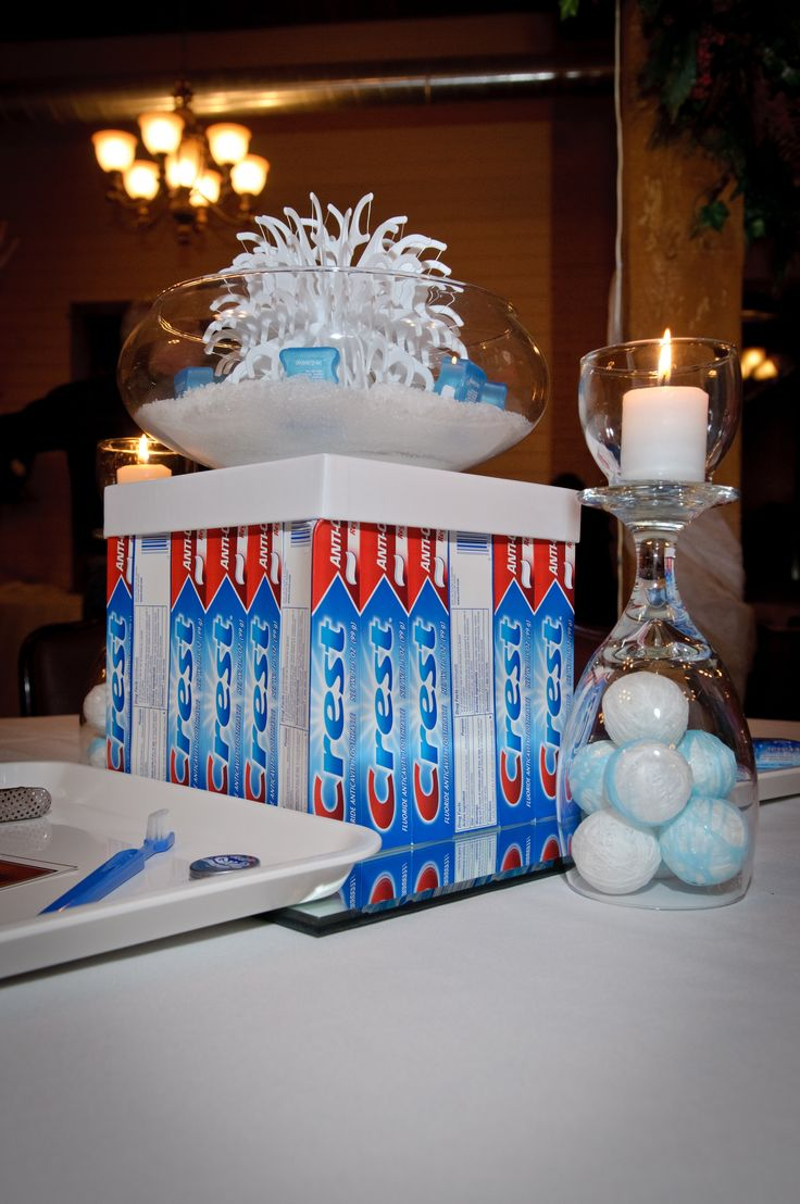 Centerpiece created for Clove Dental Makeover Reveal Party!  Dental floss wrapped styrofoam balls and dental floss picks were used to create this interesting tablescape.