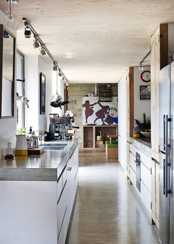 A light filled galley kitchen links the living / dining zones with the kids playroom and bedrooms beyond. Artwork on far wall by Joost's fr...