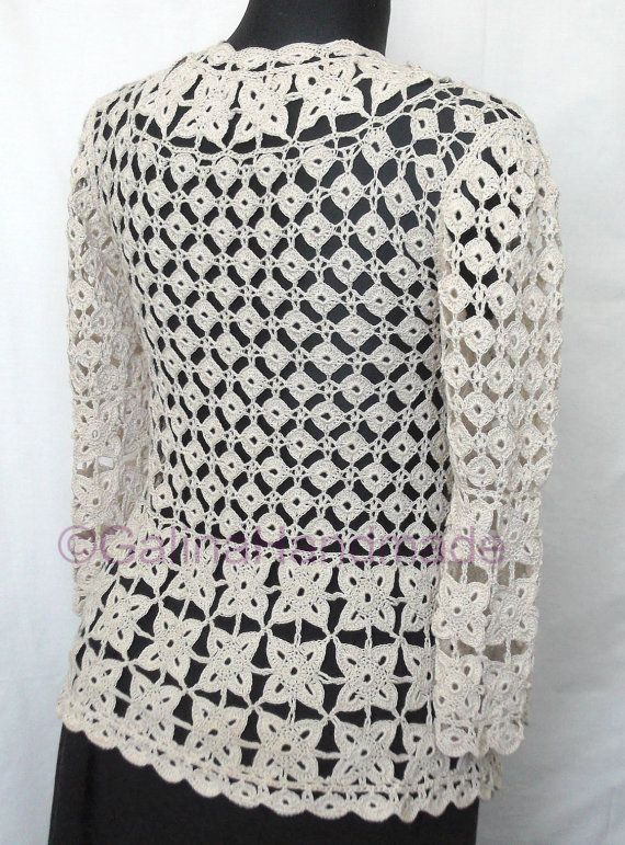The original crochet jacket with lacing is connected by a hook from 100% cotton of beige color in technics of the Irish motives and continuous