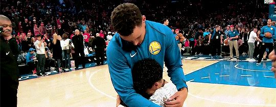 Stephen Curry with a fan!