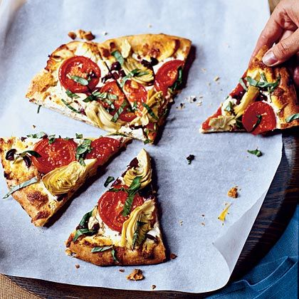 Mediterranean Pizza Recipe - Topped with veggies and on a delicious whole-wheat crust, you can enjoy two slices of a 12-inch pie for only 290 calories. The artichoke hearts scattered on top pack plenty of fiber, and the tomatoes are a great source of the antioxidant lycopene.