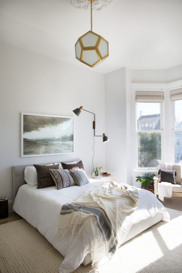 A Guest Room With Roman Shades On A Bay Window   Take A Tour Of My
