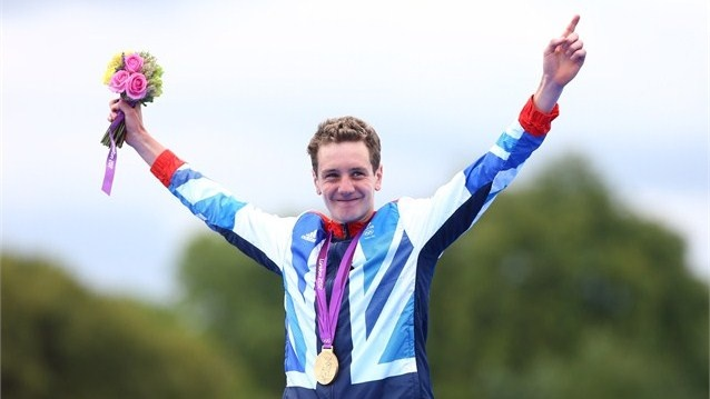 Alistair Brownlee of Great Britain celebrates with his gold medal during the medal ceremony for the Men's Triathlon on Day 11 of the London 2012 Olympic Games at Hyde Park