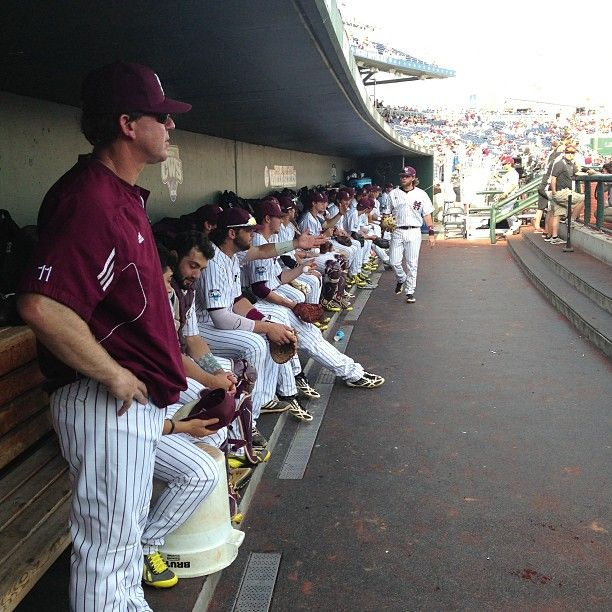 .@Coach_Cohen and the team, decked in pinstripes, wait to take the field. #HailStateCWS