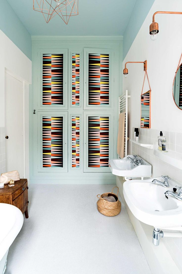 Give your bathroom an entirely new look with a fresh coat of paint and some pretty wallpaper.