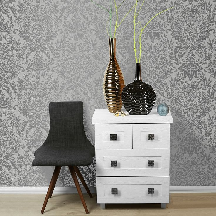Create a stunning feature wall with this elegant metallic silver and French grey damask from Crown.