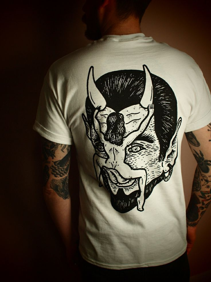 big back print of classic devil licker image and small logo on front ( pocket print)  white only . limited . S/M now available