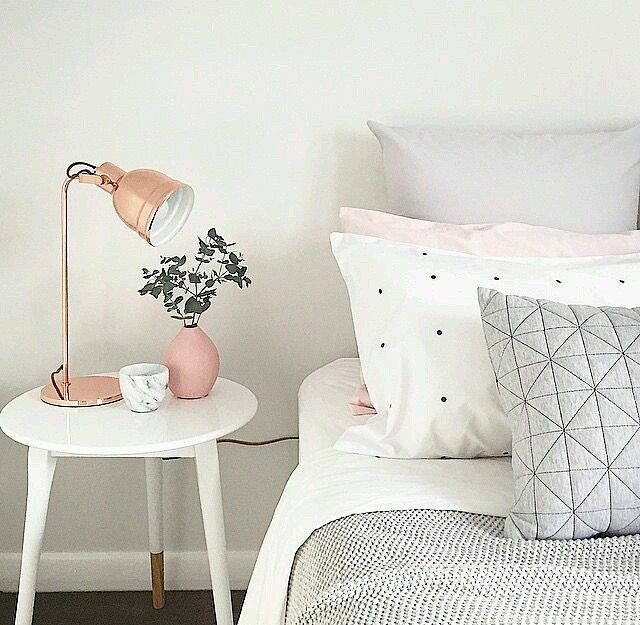 Subtle shades of rose gold to break up the grey and white Scandinavian inspired bedroom