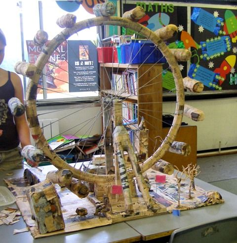 Bicycle wheel ferris wheel.  Wire and papier mache for an awesome Alexander Calder project.