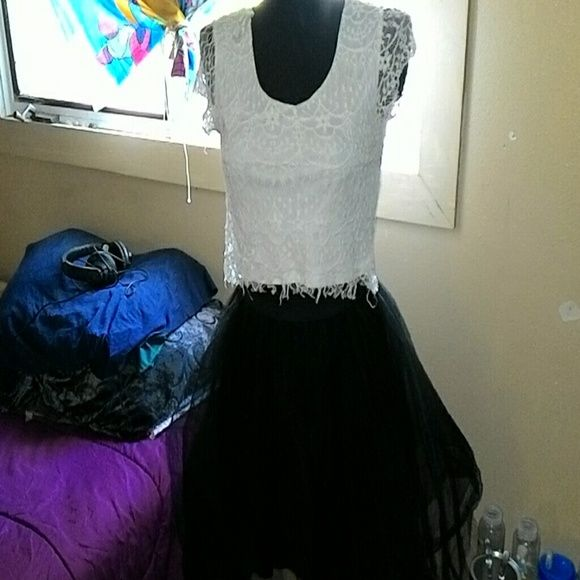 Rue 21 outfit A medium white crop top like new with a size small but can fit medium flow midi skirt. Both like new and clean without stains or tear. It is a cute outfit. Tuck in the crop top into the skirt with a buckle belt and woolah perfect outfit! Rue 21 Other