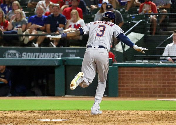 Cameron Maybin Photos - Cameron Maybin #3 of the Houston Astros extends his arms as he crosses the plate to score in the fifth inning against the Texas Rangers at Globe Life Park in Arlington on September 26, 2017 in Arlington, Texas. - Houston Astros v Texas Rangers