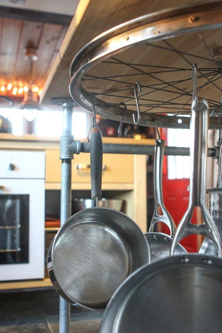 this pot rack bike wheel would work just as well above the island