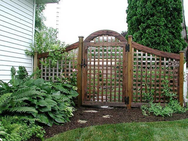 Another fun idea for a semi-private fence, screening the view passersby will have beyond.  Adding plants in front of and/or behind the fencing would increase the screening.  The gate could be a more solid pattern, too, then left open or closed, depending on the desired effect of the day!