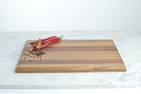 Re-purposed timber cutting board. 400mm x 260mm - Beautiful and versatile laminated timber chopping, bread or serving board made with timbers sourced exclusively from House 2067. Mixed timbers, including, Australian Hardwood, Cedar, Jarrah, Oregon and Oak.  Note: All boards retain characteristic elements of well seasoned + aged timber, making them truly unique.
