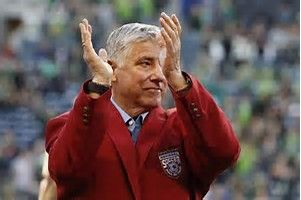 "Siegfried ""Sigi"" Schmid (born March 20, 1953) After winning the MLS Cup with Columbus (2008), Schmid was hired by the expansion Seattle Sounders as their first head coach. From 2009 to 2016, Schmid led the Sounders to seven playoff appearances, four Lamar Hunt U.S. Open Cup titles, and an MLS Supporters' Shield in 2014. He was inducted into the National Soccer Hall of Fame in 2015."