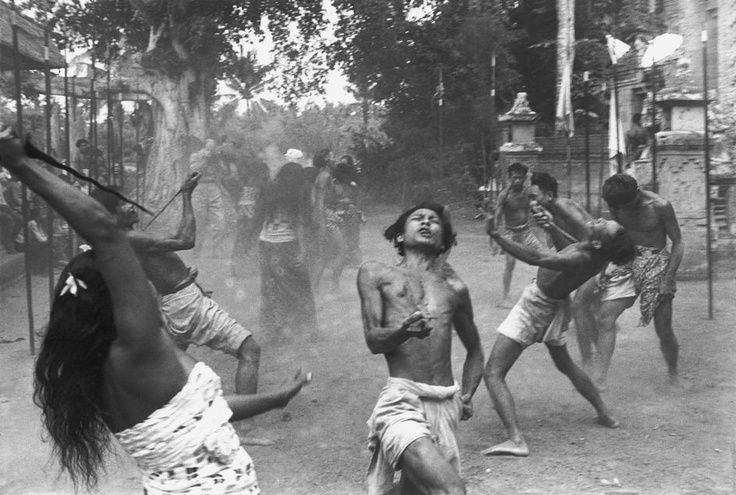 ".INDONESIA. Bali. Village of Batubulan. Barong dance. 1949. Socalled ""Kris dancers"" in a trance, they are doing the self-stabbing with kris, ngurek - Photo HCB"