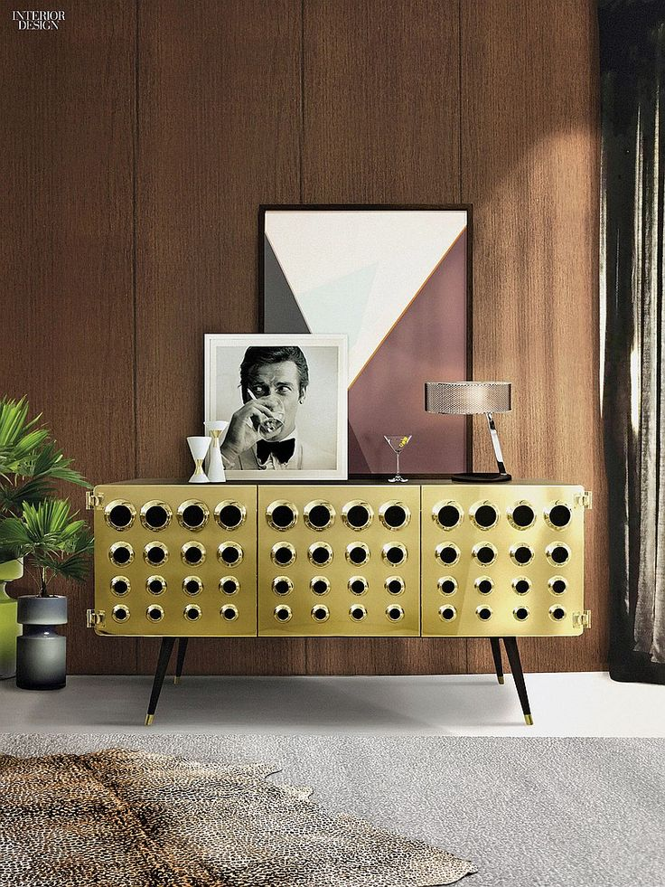 Monocles by Delightfull. The Portuguese manufacturer crafted its Monocles sideboard in solid walnut, with an eye-popping facade: clear-coated, polished brass punctuated with the circular cutouts that inspired the name. Interior Design