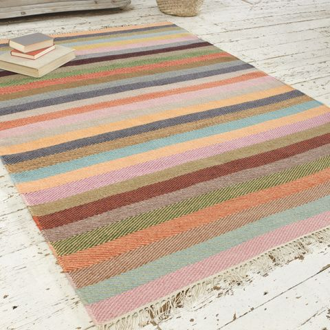 TUPPENCE. There's only one thing better than a herringbone rug, and that's a herringbone rug with a bit of colour. Muted yet bright, it's soft under foot to boot. #BonjourBlighty #rug #stripes #colours