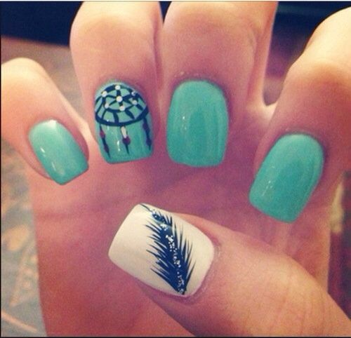 Teal, white and black nails with dream catcher and feather designs.