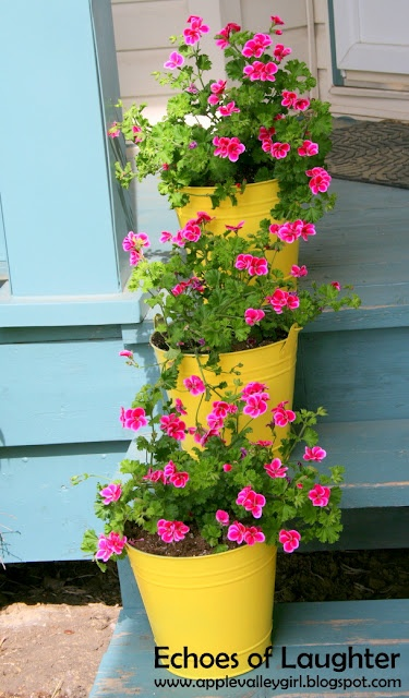 Echoes of Laughter: Spray Painted Bucket Planters... serious panache with dollar store buckets, spray paint and some pretty pink geraniums ...