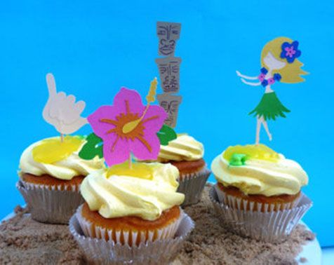 Cupcakes with paper cutout theme toppers