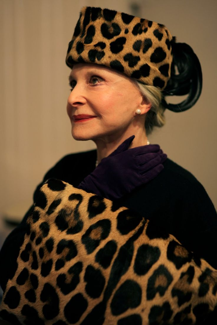 80-year-old Joyce Carpati in one of her hats that she has kept for over 50 years