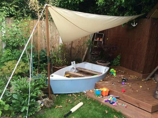 Friends we know bought an old battered rowing boat and made this amazing sand pit in their back garden. Fab!