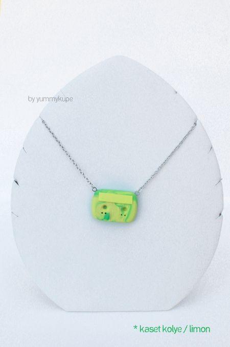 Kaset Kolye / limon  #fashion #design #miniature #food #art #miniaturefoodart #polymerclay #clay #minyatur #polimerkil #kil #nutella #tasarim #taki #sanat #moda #sokak #tutorial #yummykupe #mold #kalip #nasil #bileklik #kolye #kupe #yuzuk #aksesuar #kadin #ring #earring #accesorie #necklace #casette #lemon