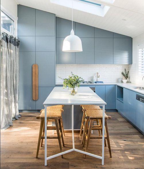 http://www.surrounding.com.au/bell-lamp-white/ #surroundingaustralia Regram : @kyalandkara #TooowonBayReno Studio Kitchen featuring beautiful @godfreyhirstau 'Regal Oak' floors in Astor colour. Cabinetry Colour: @taubmans 'Iron Gate' Stools: @ozdesignfurniture - all details on our journal at kyalandkara.com or tap for suppliers || #KyalandKara #RAMSpresents #BeachHouse #HolidayLet #Kitchen #ToowoonBay