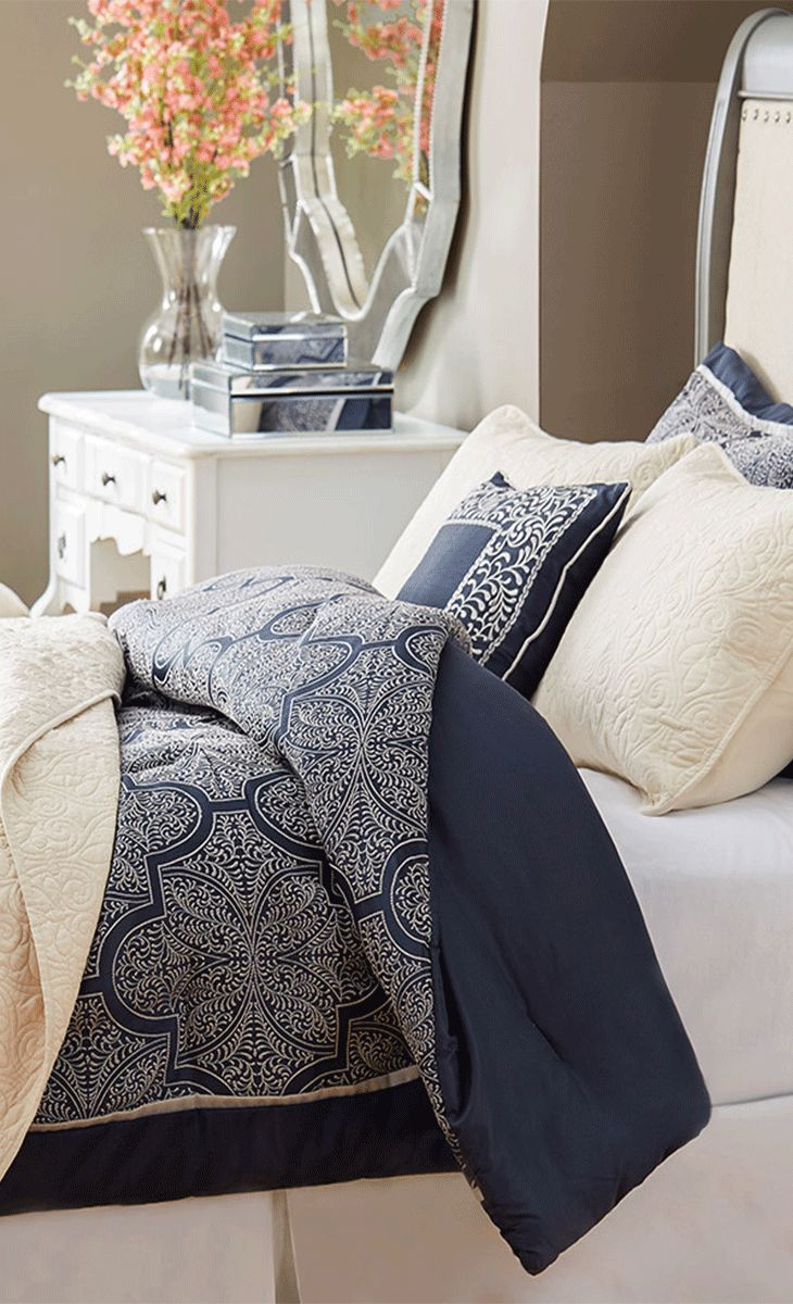 Outfit your master suite or guest room in resort-worthy style with this woven jacquard comforter set, showcasing an embroidered trellis pattern. Update your bedroom at jossandmain.com