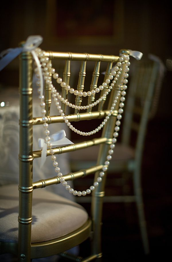 The bride and groom's chairs will have draped crystal and pearl strands with a cluster of white hydrangeas, blush spray roses, silver dollar eucalyptus and jasmine vine to one side.