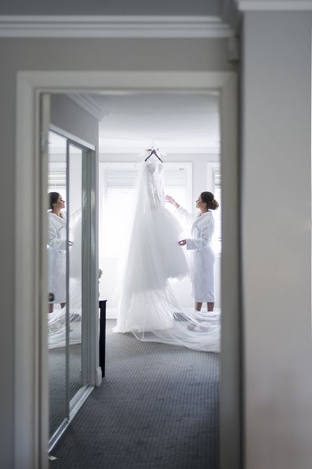 "Capturing the bride admiring her dress while reality hits that TODAY is the day she will wear it is one of our ""must have"" bridal prep shots #weddingphotography #markjayphotography #sydneyweddingphotographer #bride #weddingdress #suzannablazevic #hair @natalieannehair"
