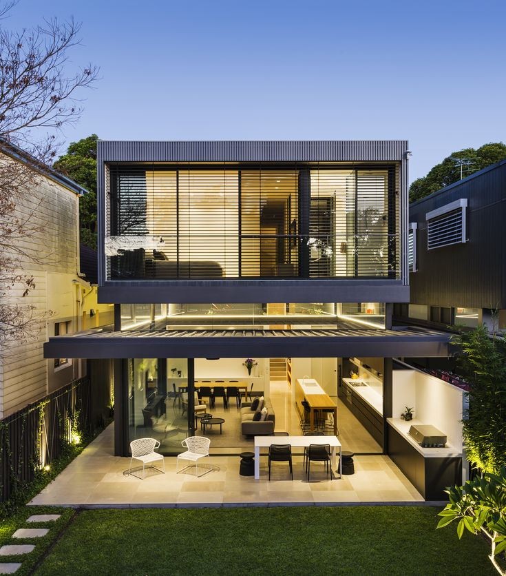 A sleek two story addition hides behind a traditional cottage in sydney