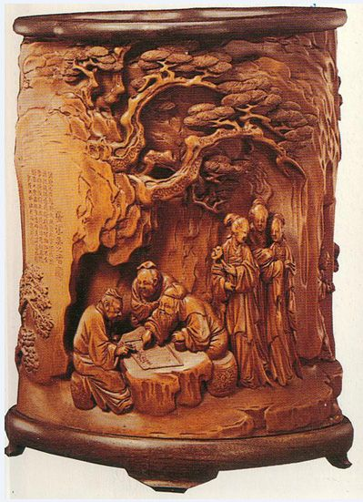 Antique Chinese wood carving that shows Go players.