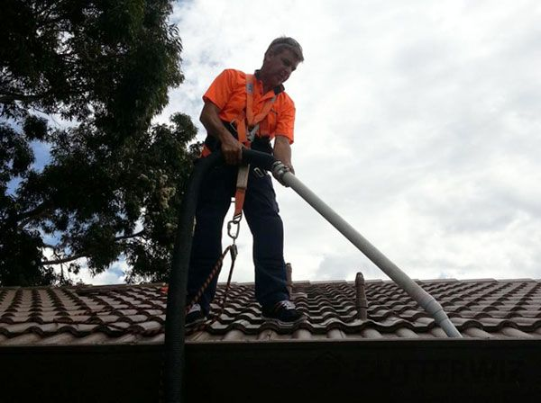 Cleaning gutters with professional staff and high powered vacuum machinery. Gutter cleaning is a something that should be done regularly as part of home maintenance in Melbourne.