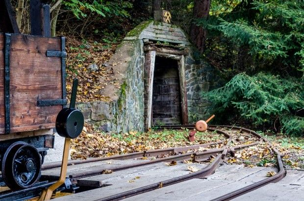 An ore cart and tracks at the outdoor Mining Museum in Banska Stiavnica, Slovakia.