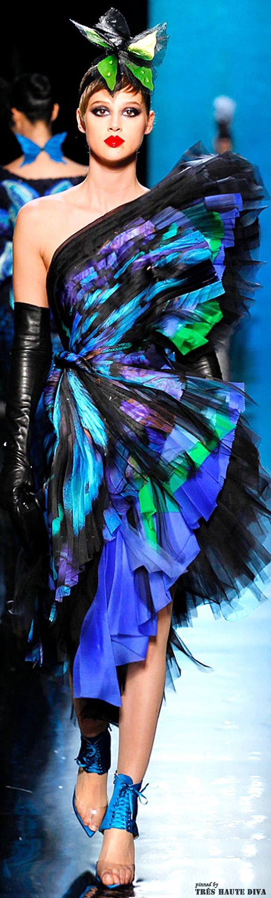 Jean Paul Gaultier Spring 2014 Couture. Butterfly, love it. His use of black and colour mixes so well together which makes this piece that much better. A truly talented man.