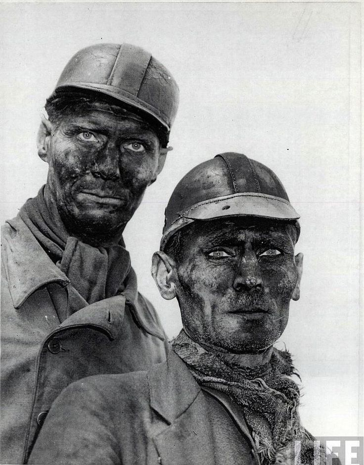 The weathered faces of two coal miners from Gelsenkirchen, Germany, post-war 1945
