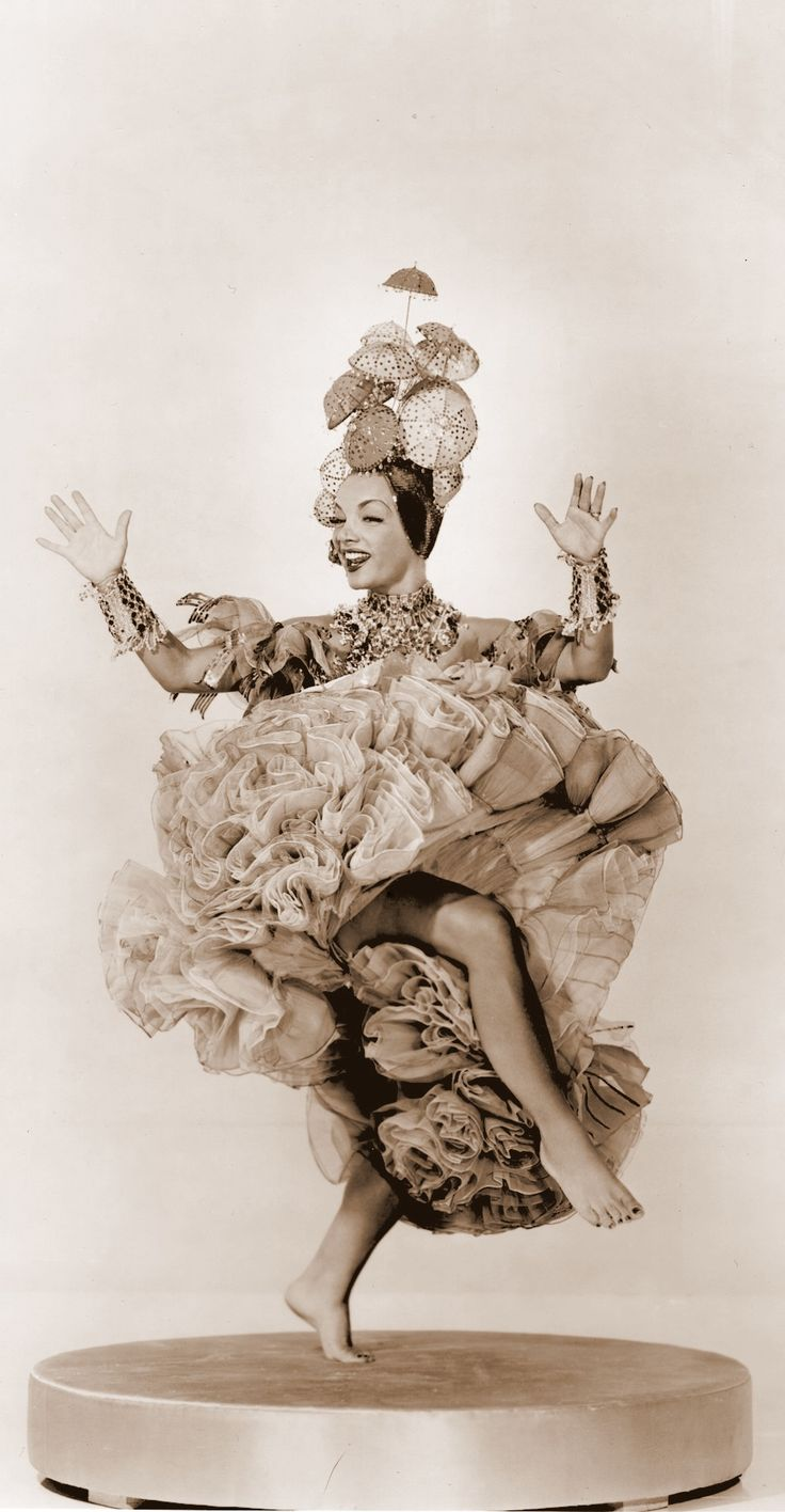 """CARMEN MIRANDA (1909-1955) comic actress/singer/dancer. Films include 'Down Argentine Way' '40, 'That Night in Rio' '41, 'Week-End in Havana' '41, """"Springtime in the Rockies' '42. 'The Gang's All Here' '43, 'Four Jills in a Jeep' '44, 'Greenwich Village' '44, 'Something for the Boys' '44, 'Doll Face' '45. 'If I'm Lucky' '46 'Cocacabana' '47, 'A Date with Judy' '48, 'Nancy Goes to Rio' '50, 'Scared Stiff' '53. (please follow minkshmink on pinterest) #carmenmiranda #forties #victoryroll"""