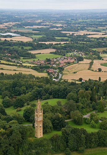 Abberley Clock Tower and Great Witley looking east over the Abberley Hills across Worcestershire, England by Flash of Light. The clock tower was built in 1883 by James Piers St Aubyn for Abberley Hall now part of Abberley Hall School  and claimed to be visable from six counties