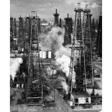 Oil drilling rigs in an oil refinery Signal Hill California USA Canvas Art - (24 x 36)