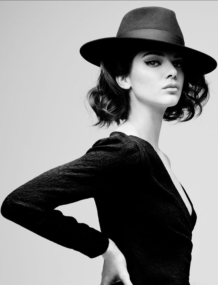 Kendall Jenner models a fedora hat with long sleeve blouse