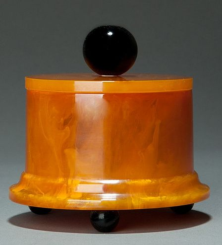 Rare Catalin Art Deco jewelry/powder box in rich marbleized butterscotch + black accents, from The Bakelite Jewelry Book by Davidov + Dawes