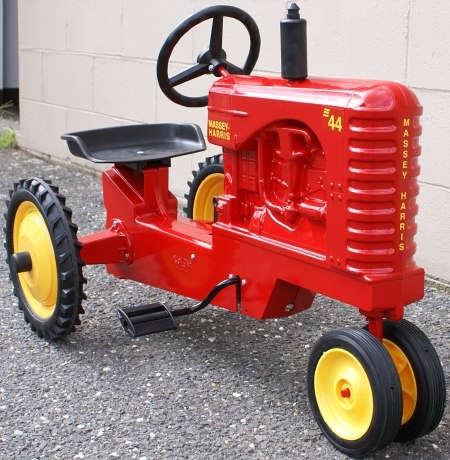 I used to play on one at my grandparents.....    awesome.  Firengine Red Tractor Pedal car