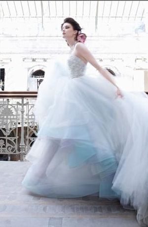 I am not one to pin wedding dresses but I LOVE the blue and purple tulle on the bottom. Lazaro - Sweetheart A-Line Gown in Tulle